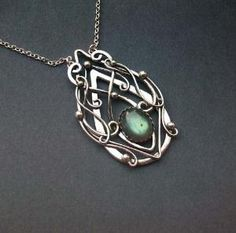 I don't know if this is old or new, but it reminds me of McIntosh designs in furniture. celtic jewelry