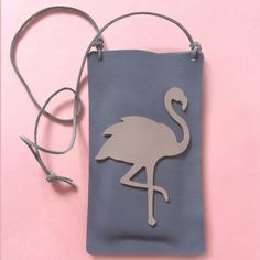 Make this leather case using two leather rectangles, a screw punch and leather cord. Super stylish and practical too!