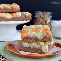 Carrot Cake Magic Bars - these gooey cake bars are loaded with pineapple, nuts, and candies. Perfect Easter treat for those dessert tables. Great Desserts, Delicious Desserts, Yummy Food, Easter Desserts, Fall Desserts, Healthy Desserts, Brownie Recipes, Cookie Recipes, Dessert Recipes