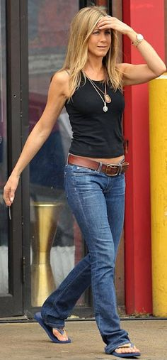 Jennifer Aniston. Simple casual style. Dress up a tank with some long necklaces!- this is my kind of casual dressing