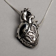 Silver anatomical heart locket by Peggy Skemp. It opens to reveal an anatomically correct interior. http://www.peggyskemp.com/products/original-silver-anatomical-heart-locket