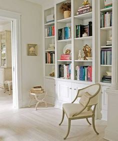 white bookcase with splashes of color