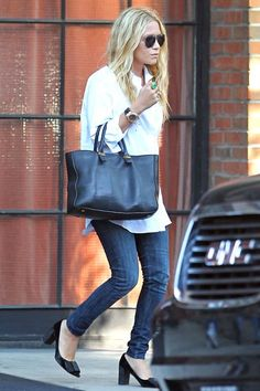 15 Ways To Do New York City Like An Olsen Twin #refinery29  http://www.refinery29.com/olsen-twins-nyc-pictures#slide-12  When: August 2011Where: East Village This might be a surprising look for Mary-Kate, but we kind of love it. Her loose white button-up pairs perfectly with her skinny jeans, glittery Miu Miu heels, and structured The Row bag as she leaves The Bowery Hotel.
