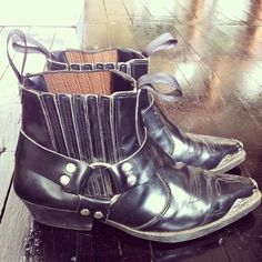 Vintage western-styled biker ankle boots. Edgy stud/strap detail.