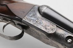 Parker Double-Barrel 16 ga. Shotgun - Lot 830 from July 2012 Auction.  DH grade, figured walnut stock with fine checkering, fully engraved receiver with original case colors, barrels with original bluing, 32 in. barrels, serial number 218804, clear bore; in modern fabric bag; permit, FFL or NICS background required.    Estimate $2,000 to $4,000