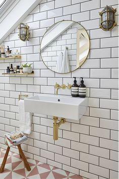 Get an on-trend bathroom with contrasting tiles, statement mirror and brass tones! 📸 Image Credit: Design by Photo by Fitting by Metro Tiles Bathroom, White Subway Tile Bathroom, Small Bathroom Tiles, Loft Bathroom, Small Bathrooms, Colourful Bathroom Tiles, Grey Grout Bathroom, Brass Bathroom Fixtures, Bathroom Colours