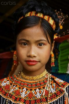 Tana Toraja, Sulawesi, Indonesia   Young Toraja girl in traditional costume at funeral ceremony   © Tuul/Robert Harding World Imagery/Corbis
