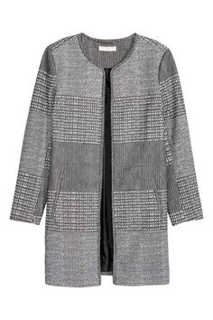 Jacket in a textured weave: Short, straight-cut jacket in a textured weave with front pockets and no buttons. Lined.