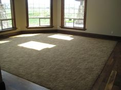 Considering hardwood around the edges of rooms otherwise carpeted.  Odd looking?  And how far in so as not to be a problem?