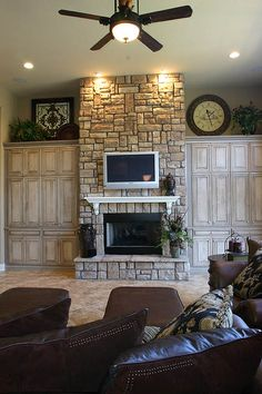 fireplace wall... Love the wood cabinets on each side. Beautiful! Wish we had a fire place!