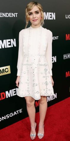 Kiernan Shipka in a white dress with laser cut details.