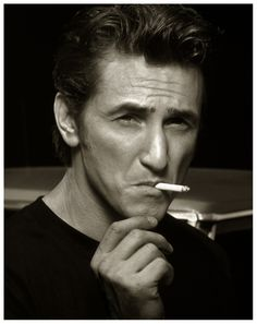 Sean Penn - yes, to me, some men are very handsome smoking a cigarette, Sean being one of them