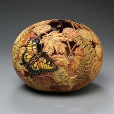 Engraving in gourd by Marilyn Sunderland