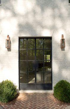Herringbone brick, clean exterior, painted brick, boxwoods