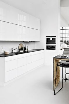 Modern Kitchen Interior White gloss cabinets with touch of wood. Don't like the black counter tops. White, minimal, with accents of bleached wood and, often, the odd design classic Classic Kitchen, New Kitchen, Kitchen Dining, Kitchen Decor, Kitchen Ideas, Kitchen White, Kitchen Layout, Desk Layout, Kitchen Rustic