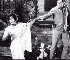 Actress Shamim Ara with Actor Mohammed Ali doing a singing/dancing performance on a movie set | Pakistan.