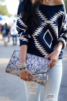 Love the sweater and  jeans. Good idea to use the oversized clutch but I would choose a different one