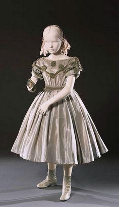 Silk taffeta dress with velvet ribbon, lace, and rhinestones. 1860s. Courtesy of the Philadelphia Art Museum.