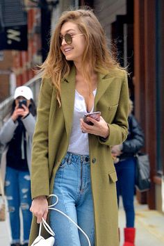 ↞ She looks so pretty in this! She makes it look so easy and casual. I'd probably look like a turtle in that jacket