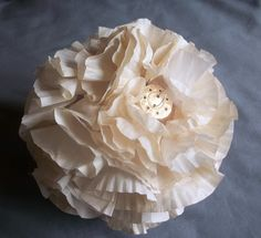i'm so in love with this! diy flower ball ornaments made from cupcake wrappers!