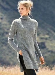 Our contemporary spin on the classic Aran cable knit, in exotically soft, woolen-spun royal alpaca. Styled with ribbed t-neck, saddle shoulders and extra deep side slits.