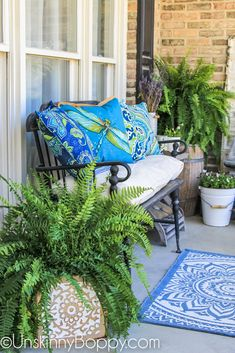 Black wrought iron bench with blue dragonfly pillows on porch get tips for decorating a narrow front porch for spring, along with an instructional video Wrought Iron Bench, Small Front Porches, Front Deck, Front Stoop, Bench Decor, Building A Porch, Summer Porch, Beach Porch, House With Porch
