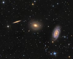 The Draco Group, in Draco. L-R: edge-on spiral NGC 5981, elliptical galaxy NGC 5982,  face-on spiral NGC 5985:  all w/in this single telescopic field of view spanning a little more than 1/2 the width of the full moon. The group is far too small to be a galaxy cluster: these galaxies all lie about 100 mly from Earth