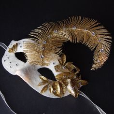 White and gold masquerade mask with crystal accents