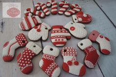 Sugar Christmas Cookies With Royal Icing Decorations That Looks Like Real Knitted Mittens and Stockings.