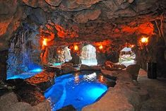 Natural Pools, Waterfalls, Lagoons and Rockwork eclectic pool - hot tub and seating area and waterfall inside the grotto
