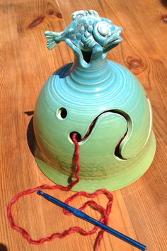 Yarn Bell. 'Fish out of water'.  A blend of green and blue glossy glaze.
