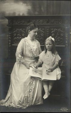 Queen Wilhelmina with her only child,  Princess Juliana of Netherlands,  on a bench c1910.