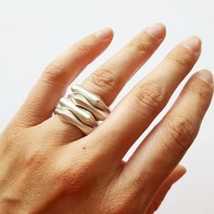Each of these rings are sold individually, they are pictured stacked b/c I love how they nestle together. It turns into a hand sculpture :) Although square, each ring is super comfortable and has a nice, gentle weight to it. Choose your size and perhaps you want more than one?