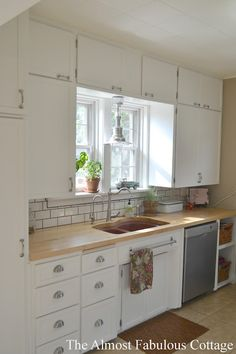 white cottage kitchen- The Almost Fabulous Cottage