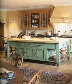 I want a clean Craftsmen flavored modern kitchen with a hefty vintage island like this ...not this color,