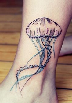 Simplistic jellyfish tattoo on the ankle. The simple inking of this design is what makes it special as it looks neat and clean and perfect for the place here it is tattooed on.