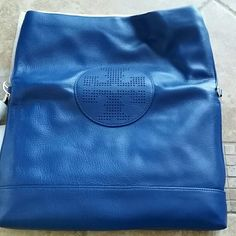 "NWT blue tory burch messager bag authentic, brand new with tag, magnetic snap closure. one interior zip pocket and two open pockets, adjustable, removable strap. can be use as a shoulder bag/crossbodybag/clutch/messager bag. 12""lx8""hx2""d Tory Burch Bags Crossbody Bags"