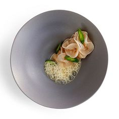 Geoduck, pickled cucumber and essence of lime leaf by Chef @shergatt! #theartofplating #gastroart #food #foodie #foodart #foodpic #edibleart #foodphoto #foodphotography #foodphotographer #instafood #gastrogram #gourmet #gastronomy #nyc #nyceats #nycdining #nycfoodphotographer #signebirckphotography