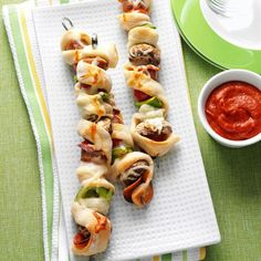 Pizza on a Stick Recipe -My daughter and her friends had fun turning sausage, pepperoni, veggies and pizza dough into these cute kabobs. Give our version a try or make your own using you favorite light pizza toppings. —Charlene Woods, Norfolk, Virginia