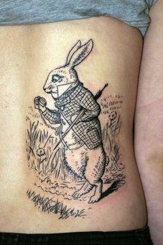 Alice in Wonderland Tattoos - Inked Magazine Alice In Wonderland Flowers, Alice And Wonderland Tattoos, White Rabbit Tattoo, Rabbit Tattoos, Bunny Tattoos, Cartoon Tattoos, Disney Tattoos, Cartoon Drawings, Body Tattoo Design