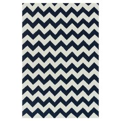 Bring a touch of glamour to your master suite or walk-in closet with this hand-hooked rug, showcasing a chic chevron motif in a classic ivory and ink palette...