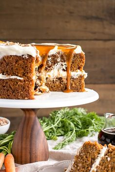 Spiced carrot cake layers infused with maple syrup and topped with maple caramel & cream cheese frosting.   livforcake.com