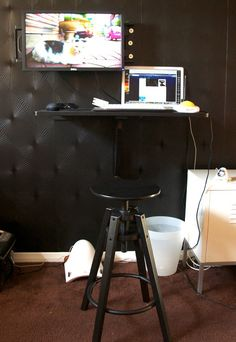 When I turned my former roommate's bedroom into my home office, I knew I wanted a standing desk. But which kind? Most that are for retail sale are on the pricey side and many of the DIY versions look very handmade with their stacks of boxes or reams of paper to prop up monitors and peripherals. Then, I had an idea...