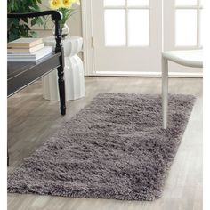 This hand-woven acrylic shags offer luxurious comfort in a trendy lifestyle rug. High-density acrylic pile features a grey background and provides one of the most plush feels available in a rug.