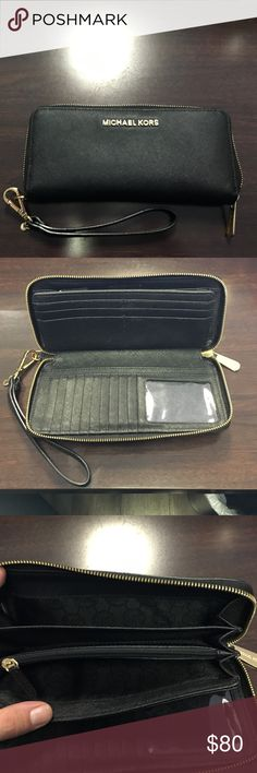 Michael Kors jet set continental wristlet Used once  only selling because I got 2 for my birthday lol  In perfect condition  The only wear is in the last picture. I LOVE this wallet! It holds everything I need and then some. Will discount if purchased with matching purse MICHAEL Michael Kors Bags Wallets