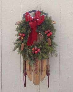 A vintage sled simply decorated with a wreath!