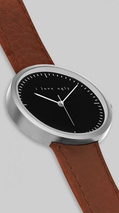 "Not sure about the ""i love ugly"" I think its a beautiful watch!  Black Nut Watch"