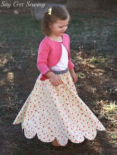 Free pattern: Little girls long flutter skirt with a scalloped hem : Charity from Say Grr Sewing shares a free pattern for this little girls long flutter skirt. It has a beautiful scalloped hem that's especially fun to twirl. It's reversible, too, so y… Girls Skirt Patterns, Skirt Patterns Sewing, Skirt Sewing, Coat Patterns, Blouse Patterns, Clothes Patterns, Little Girl Skirts, Skirts For Kids, Kids Outfits Girls