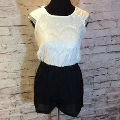 COLOR BLOCK JUNIOR SHORTS ROMPER Pretty white lace at the top and black on the bottom with elastic banded waist and zip back. Front pockets. Like new Shorts