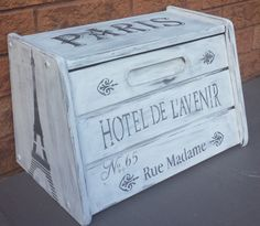REFINISHED WOOD BREAD BOX IS CHALK PAINTED IN WHITE WITH HAND PAINTED ACCENTS IN…